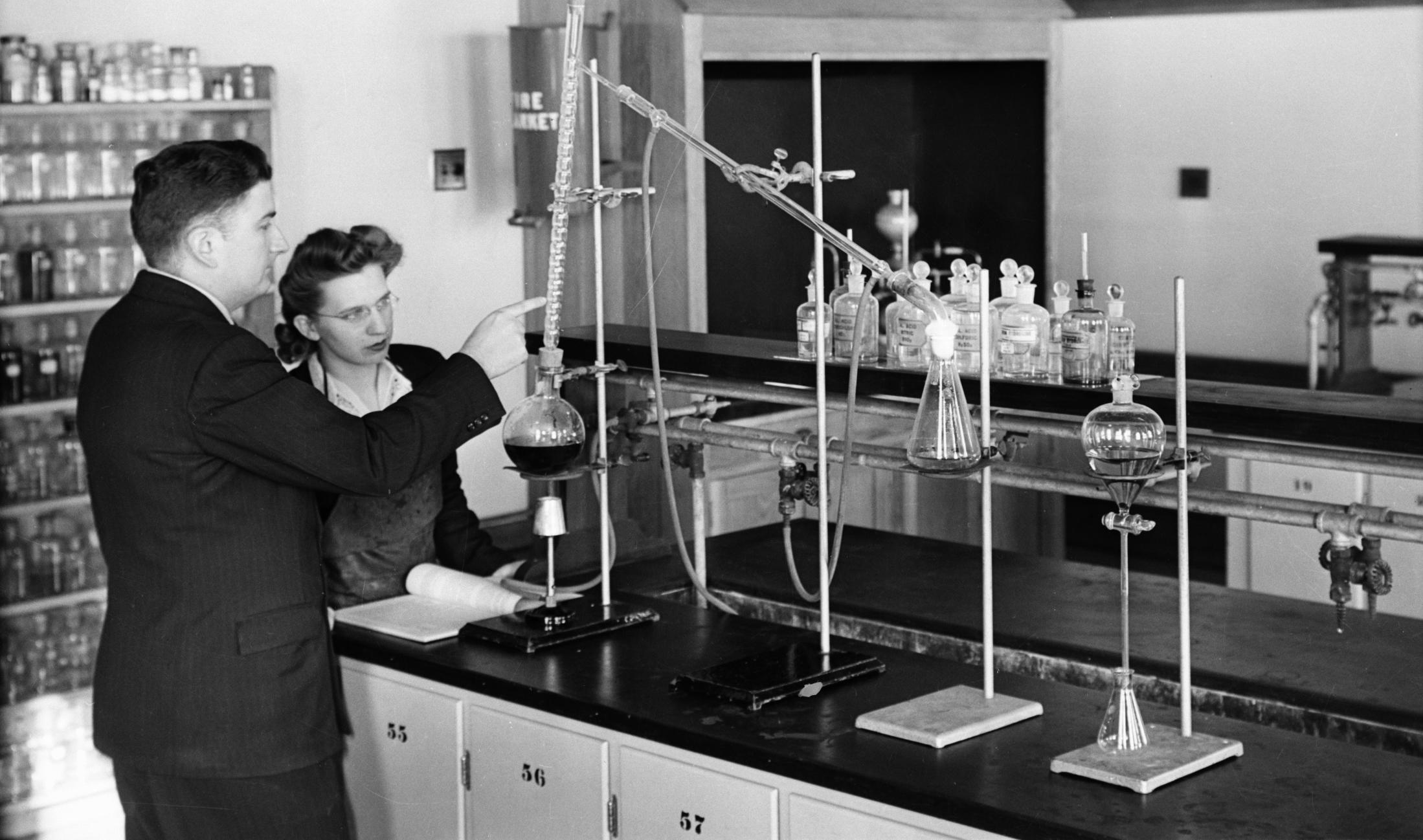 Vintage photo of chemistry student and professor