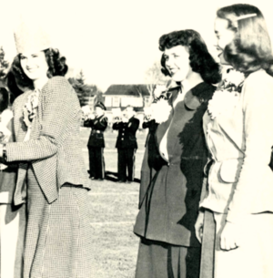 """JoAnne Devine (left) with Homecoming Court members Kathleen """"Kitty"""" Bocklund (center) and Alice Anderson (right). JeannePeterson and Beatrice Koski were also members of the court."""