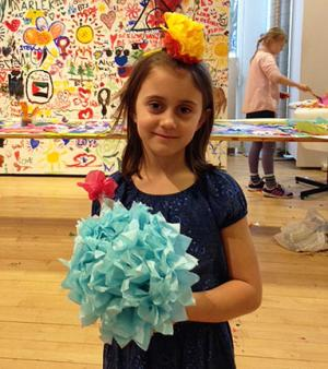 Child holding paper flower