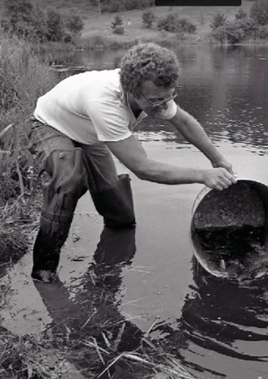 A biology student at Bagley Pond