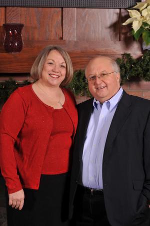 Beth and Kurt Heikkila standing by their mantel