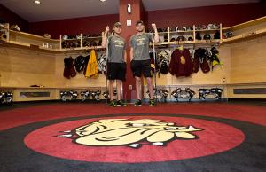 Men's Hockey players Dominic Toninato and Carson Soucy in the Bulldog's locker room