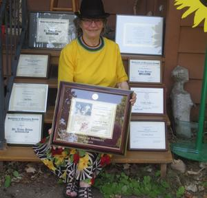 Linda and plaques