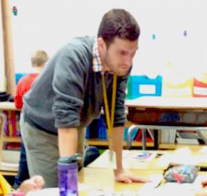Jackson Pray works with students in his classroom.