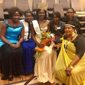 Friends gather around Awel after she was named Miss South Sudan 2018.
