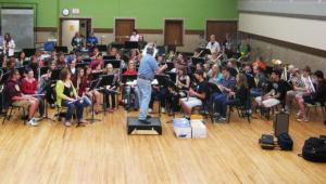 Professor Mark Whitlock conducts NSSME rehearsal