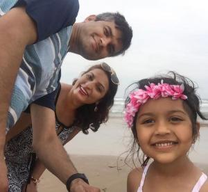 Prabhat, Sharmila, and Arya on a beach adventure.