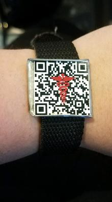Picture of Katelyn's QR braclet. It has the medical symbol in the center without obstructing the code.