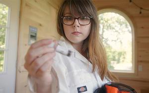 UMD student Raina Costello looks at a test tube