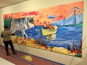 UMD student helps paint the Adam Swanson mural in UMD's Tweed Museum of Art