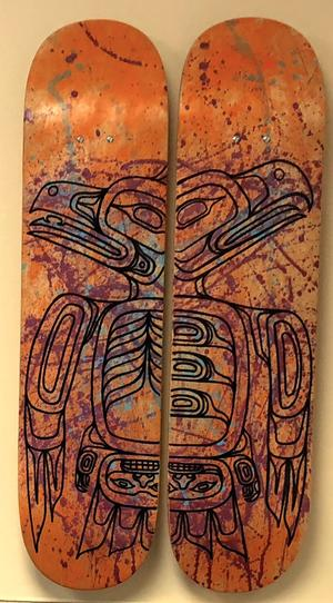 In the office of Dr. Mary Owen, the image of Tlingit eagles are carved on two wooden snowboards.