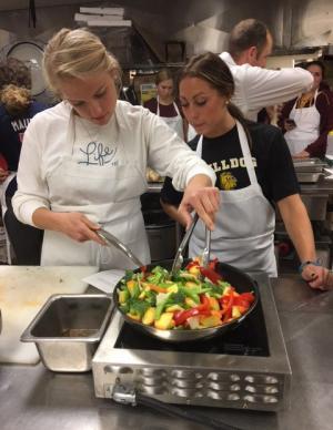 UMD softball players cooking