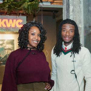 """TaVanni Singleton '08 with her friend and stylist Benjamin Kontoh at Shanghai Black Fashion Week. TaVanni says,""""It's like a lion. Africans connect with it because of its strength and its courage."""