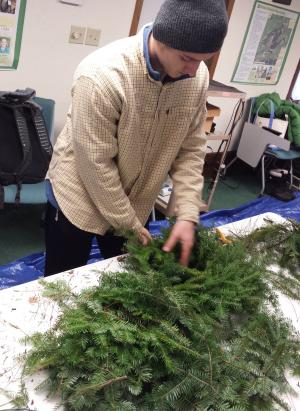 Trevor Struve practices his wreath making skills.