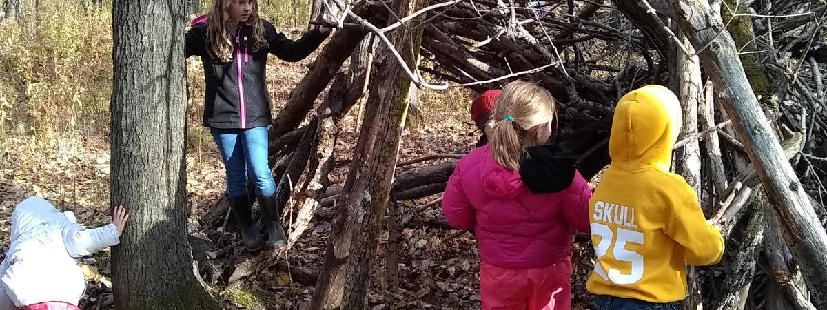 Children at the fort they built at Stowe Elementary school