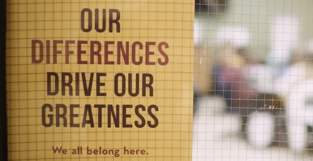 "A sign on a classroom door reading ""Our Differences Drive Our Greatness"""