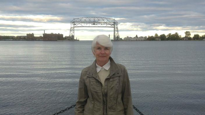 Ann Lewis, with the Duluth lift bridge in the distance behind.