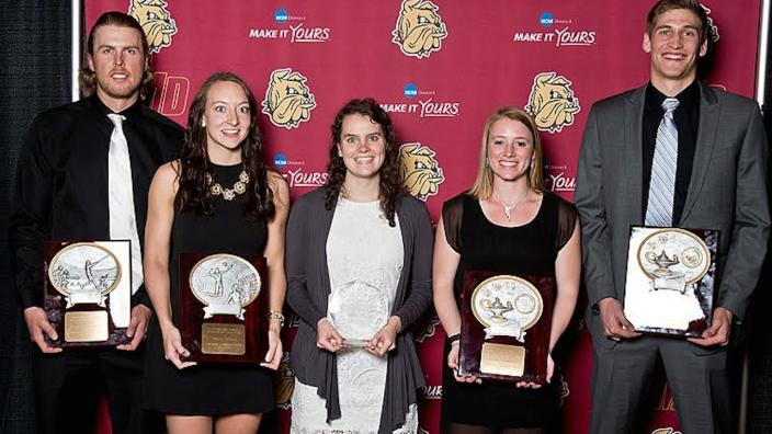 Five athletes receive top awards at the athletic banquet.