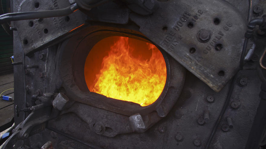 Fuel burning in historic train engine's firebox