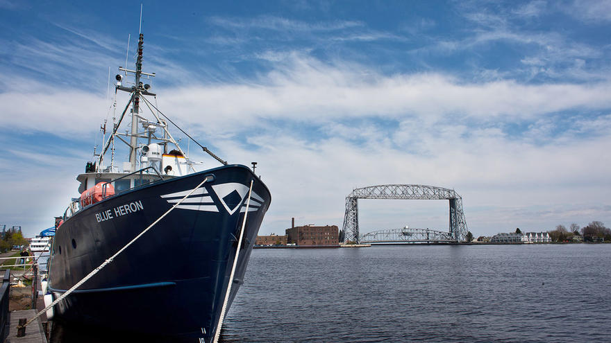 UMD's research vessel, the Blue Heron, docked with Aerial Lift Bridge in the background