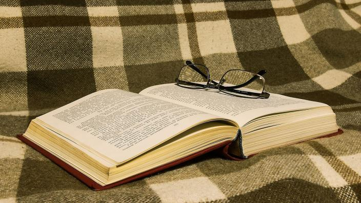 Book on a plaid blanket