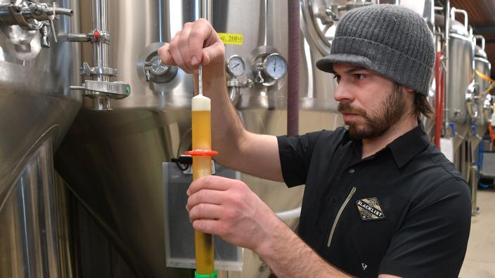 Brian Schanzenbach's at Blacklist Artisan Ales measuring yeast