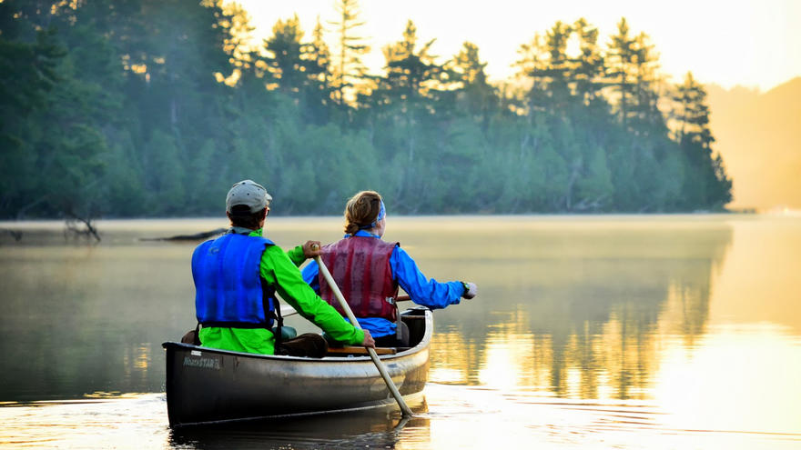 Two people canoeing in a lake