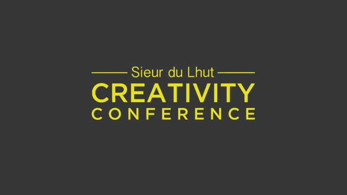 "Yellow copy on grey background ""Sieur du Lhut Creativity Conference"""