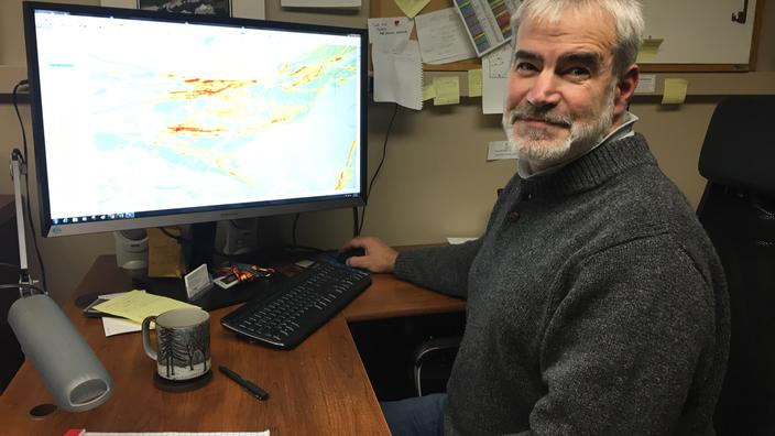 NRRI Senior Geologist Dean Peterson at his computer