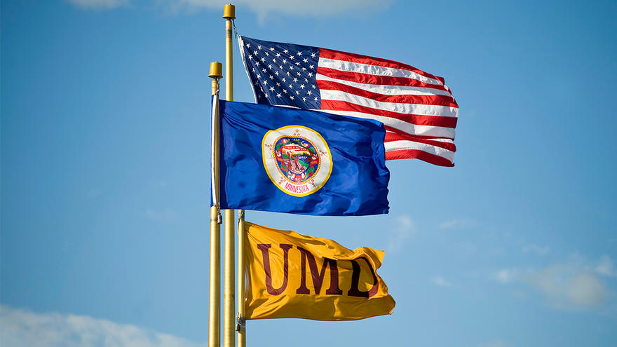 UMD, US, and Minnesota flags