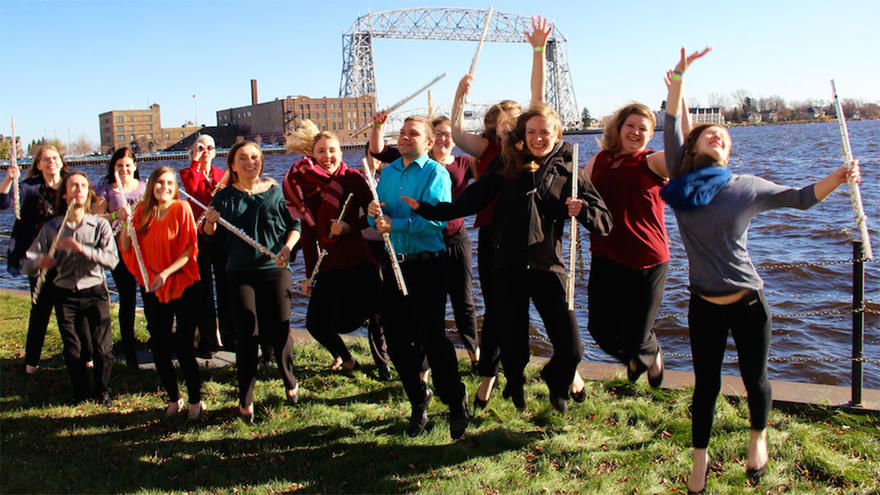 UMD Flute Workshop participants jumping by Lake Superior
