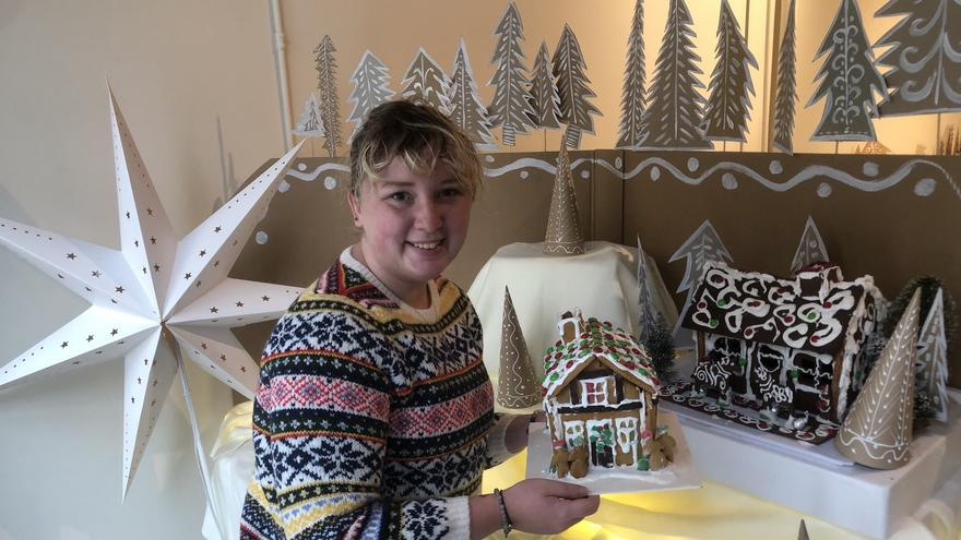 Anabelle Putz sets up the gingerbread village.