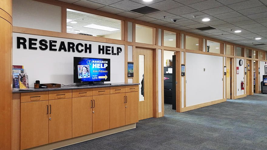 UMD Library hallway with Research Help sign