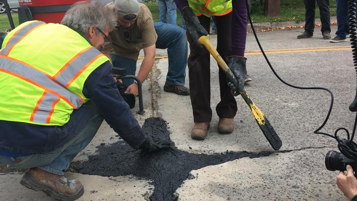 Researchers fill pot hole on street
