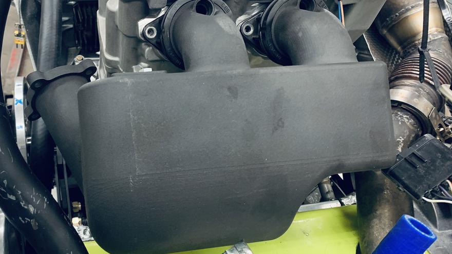 Grey prototype of snowmobile intake manifold