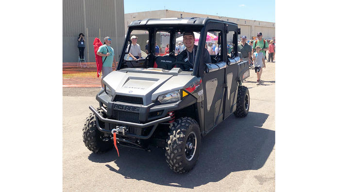 UMD student Jon Emhke behind the wheel of a Polaris Ranger at the Duluth Airshow