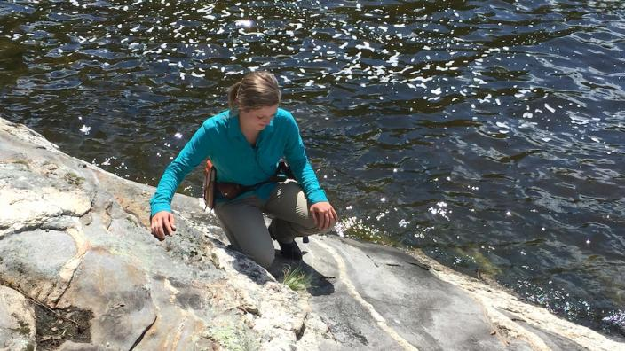 Ann Hunt studies geology in Voyageurs National Park.
