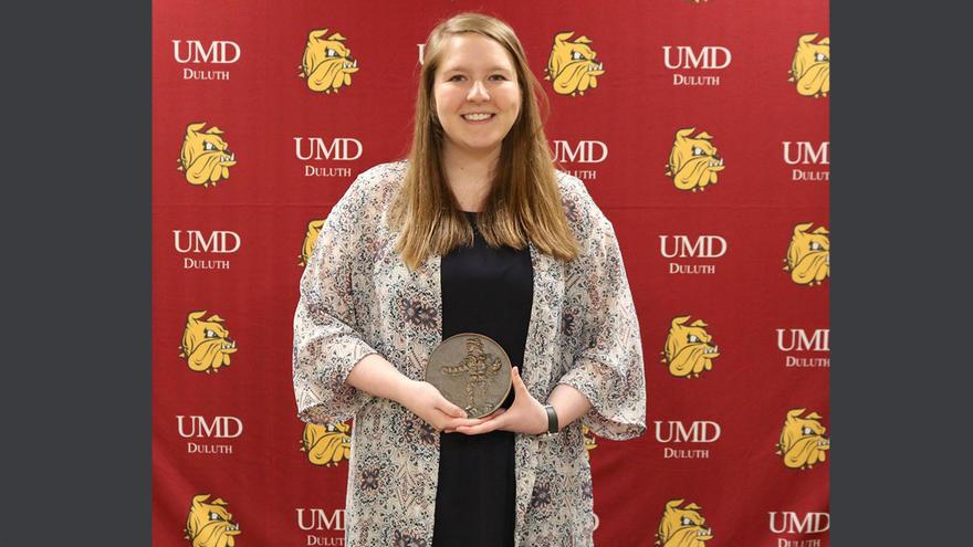 UMD Student Lindsey Dirks holding Sieur du Luth Award