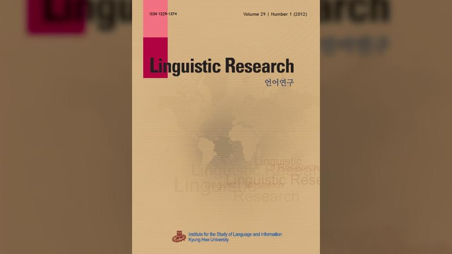 """Piece of paper with the words """"Linguistic Research"""" and blurry world map on it."""