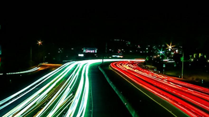Night shot of headlights on a highway