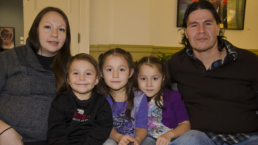 An American Indian man and women with three little girls
