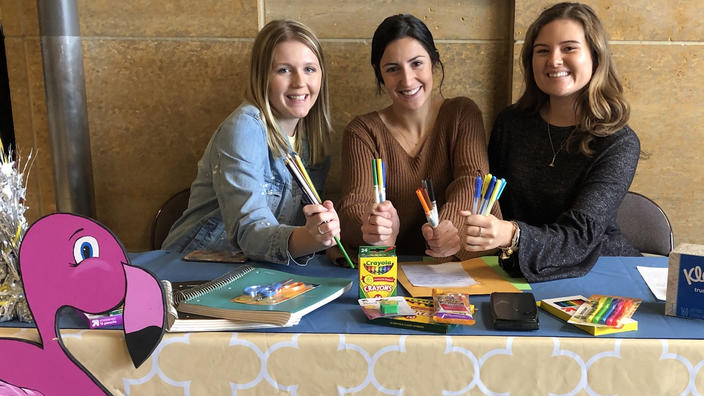Phi Sigma Sigma students at the school supply booth
