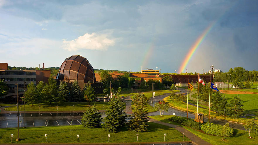 UMD campus with double rainbow in the sky