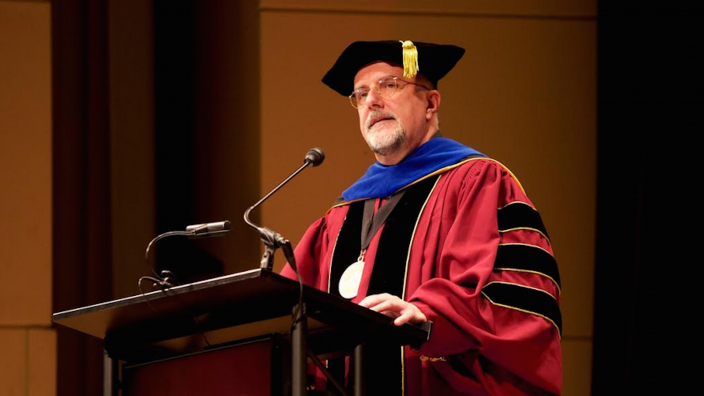 President Richard Senese at a Capella graduation ceremony