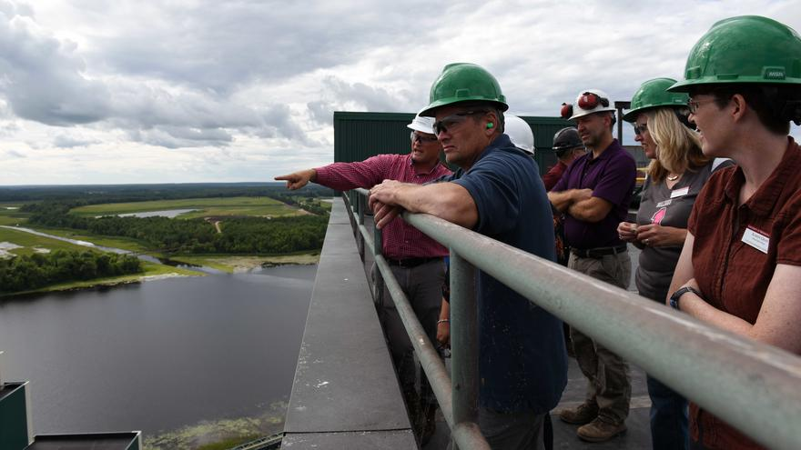 A group of SCSE professors standing on an Iron Range observation deck.