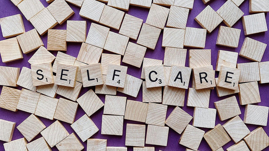 """Scrabble titles and the words """"Self Care"""" spelled out"""