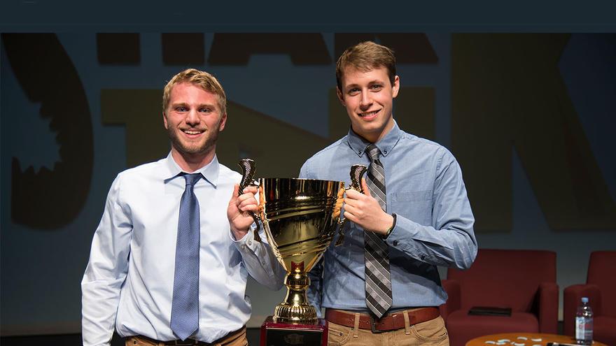 UMD Shark Tank winners Andrew Knoll & Joe Kastner (Knoll Restorations) holding trophy
