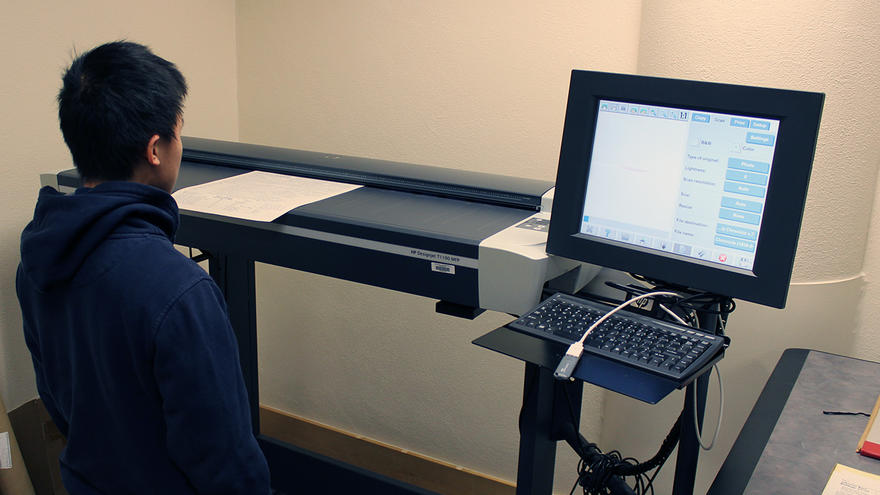 UMD student looking at a computer monitor