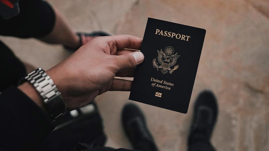 A hand holding a passport