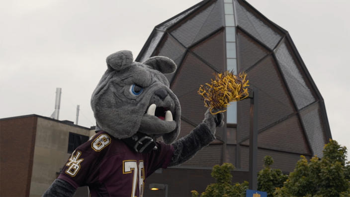 Champ with Webber Music Hall in the background during the 2017 Homecoming